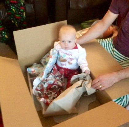 baby sitting in a box